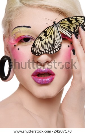 Beautiful blond girl with bright makeup and big tropical butterfly on her face - stock photo