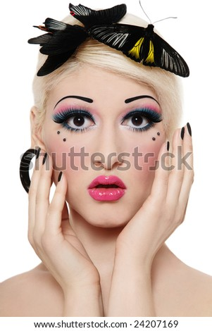 Beautiful blond girl with bright makeup and three tropical butterflies on her head - stock photo
