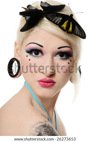 Beautiful blond girl with bright makeup and tropical butterflies on her head - stock photo