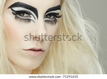 Beautiful blond girl with cat eyes make-up in black and white - stock photo