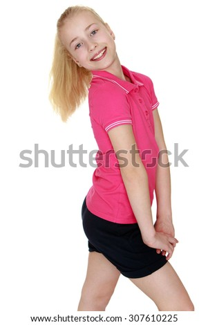 Beautiful blond girl with gray eyes turned sideways to the camera. The girl wearing the pink Jersey with short sleeves and short black shorts . closeup-Isolated on white background - stock photo