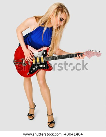 Beautiful blond girl with guitar on white background - stock photo