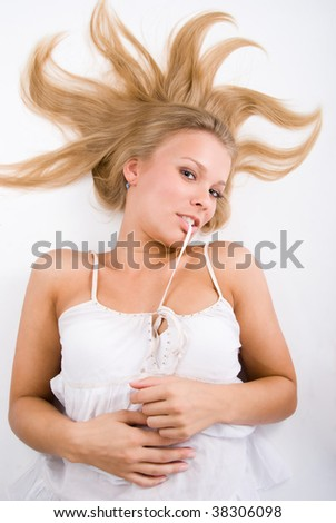 Beautiful blond girl with long hair - stock photo