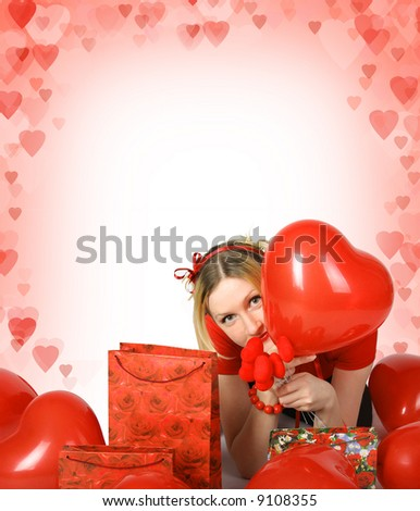 beautiful blond girl with shining hearts and presents - stock photo