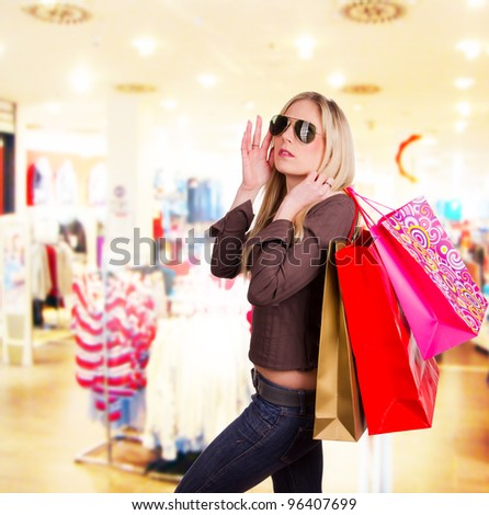 Beautiful blond girl with shopping bags