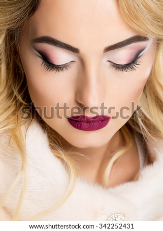 beautiful blond girl with stylish make-up