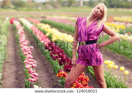 Beautiful blond  girl with tulip flowers, amazing spring photo from Latvia, Baltic states, Europe - stock photo