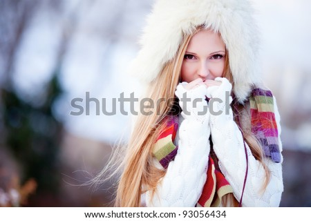 Beautiful blond hair girl i winter clothes - stock photo
