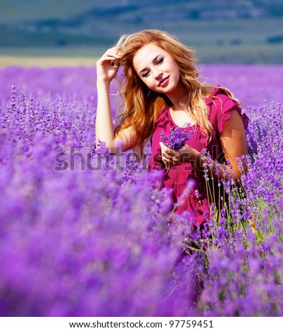 Beautiful blond hair girl in lavender meadow - stock photo
