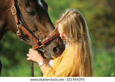 beautiful blond hair girl tender horsemanship - stock photo