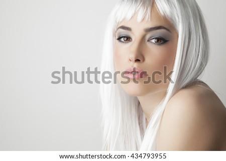 beautiful blond hair woman, studio portrait white background - stock photo