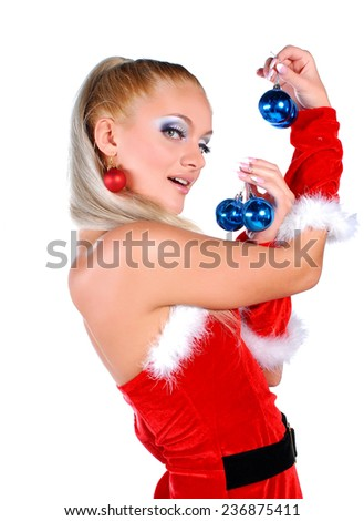 Beautiful blond in christmas costume holding balls - stock photo
