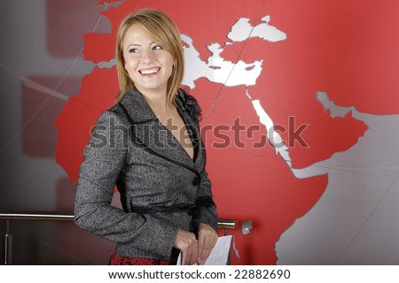 Beautiful blond journalist smiling in television studio - stock photo