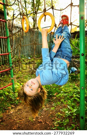 beautiful blond little model girl with blue eyes in casual kid clothes on the playground - stock photo