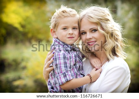 Beautiful blond Mother and Cute son Portrait - stock photo