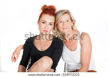 beautiful blond mother and daughter ore. Family relationships, love, affection. Adult mother and daughter huddled together. over white