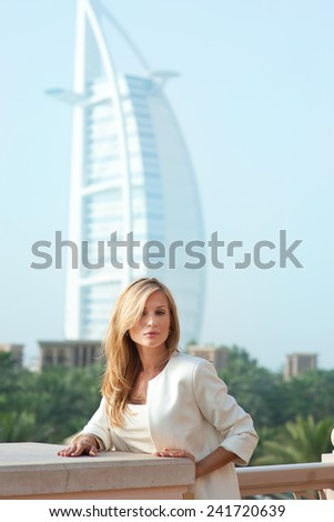 Beautiful blond russian professional model girl having joy and relax in luxury spa resort in tropical country with blue sky background - stock photo
