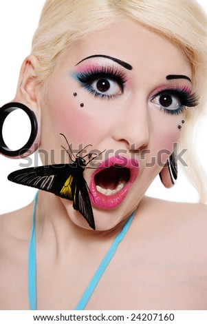 Beautiful blond scared girl with bright makeup and big tropical butterfly on her face - stock photo