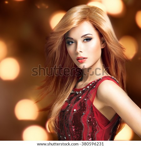 Beautiful blond sexy woman with long hairstyle poses at studio over art creative background - stock photo