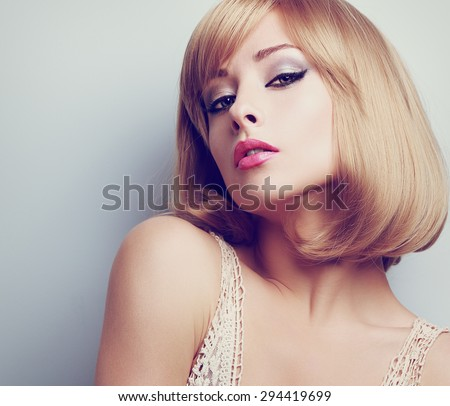 Beautiful blond sexy woman with short hairstyle. Toned color closeup portrait - stock photo