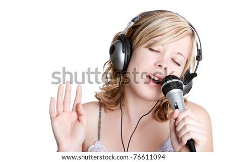 Beautiful blond singing music girl - stock photo