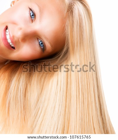 Beautiful Blond Smiling Girl. Blonde Woman with Blue Eyes. Healthy Long Blond Hair. - stock photo