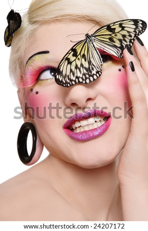 Beautiful blond smiling girl with bright makeup and big tropical butterfly on her face - stock photo