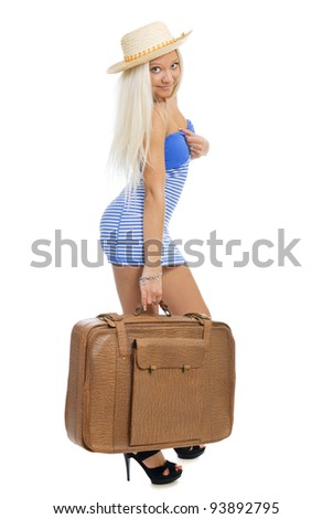 Beautiful blond traveler woman with a bag isolated on white background.