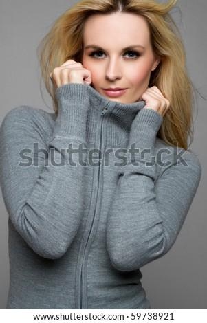 Beautiful blond winter fashion woman - stock photo