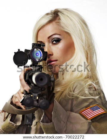 Beautiful blond woman aiming with army sniper rifle