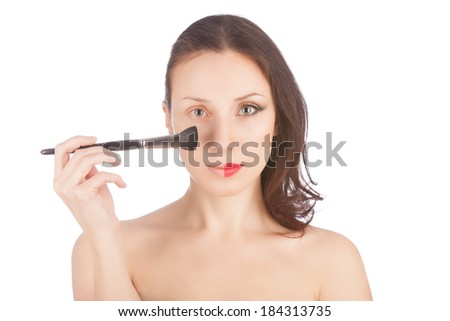 Beautiful blond woman: before and after makeup with a make-up brush over white  - stock photo