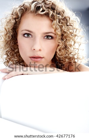 Beautiful blond woman, Curly hair - stock photo