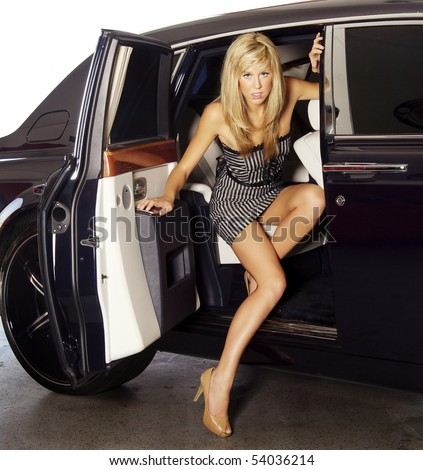 Beautiful Blond Woman Exiting A Luxury Car To Attend A