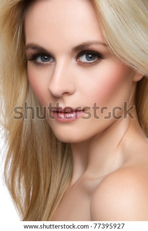 Beautiful blond woman face closeup - stock photo