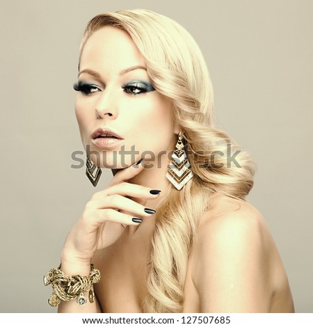 Beautiful blond woman.  Fashion photo - stock photo