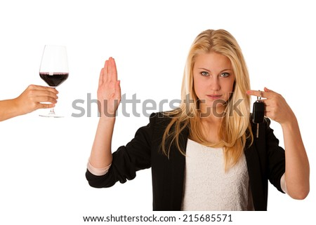 beautiful blond woman gesturing don't drink and drive gesture, with refusing a glass of red wine isolated over white - stock photo