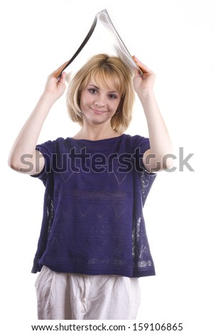 beautiful blond woman in a blue shirt with a yellow folder in hands, in the studio on a white background