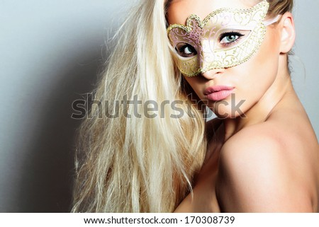 Beautiful Blond Woman in a Carnival Mask.Masquerade. Sexy Girl. Beauty & Fashion - stock photo