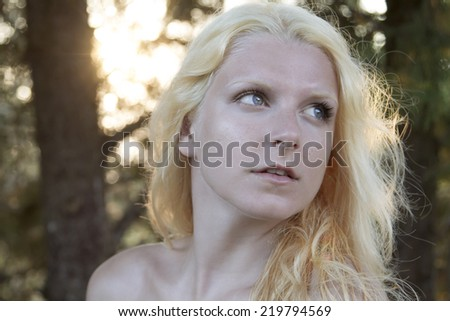 Beautiful blond woman in a forest