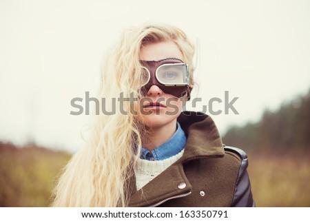 beautiful blond woman in aviator sunglasses - stock photo