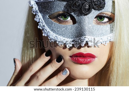 Beautiful Blond Woman in Carnival Mask.Masquerade. Sexy Girl. Lovely.Manicure.Nail design - stock photo