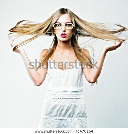 beautiful blond woman in glasses - stock photo