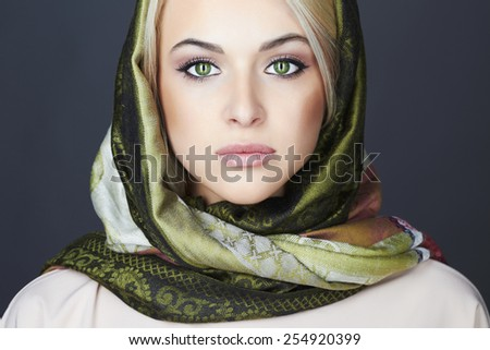 Beautiful blond woman in scarf.winter fashion.Beauty Girl.Classic Russian style.close-up make-up portrait - stock photo