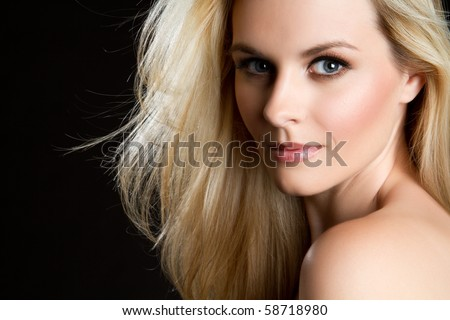 Beautiful blond woman on black - stock photo