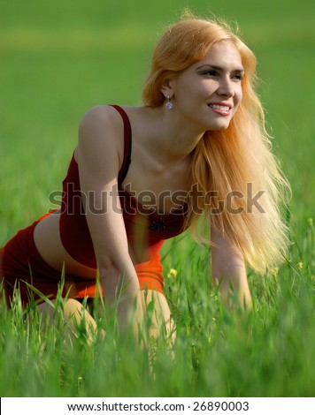 beautiful blond woman on the green field - stock photo