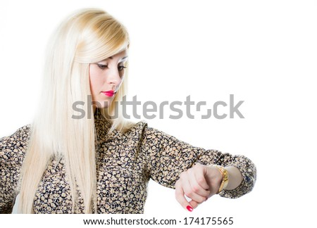 Beautiful blond woman portrait checking wrist watch isolated over white background - stock photo