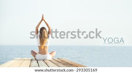 Beautiful blond woman practicing yoga at seashore and meditating  - stock photo