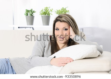 Beautiful blond woman relaxing at home - stock photo