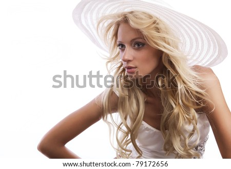 Beautiful blond woman wearing a hat - isolated over white.