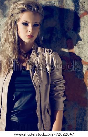 beautiful blond woman wearing leather jacket. Fashion photo - stock photo